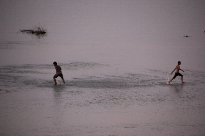 Playing soccer on the riverflats of the Irrawaddy