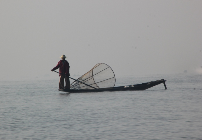 Rowing with your feet and fishing with these big nets are an Inle tradition