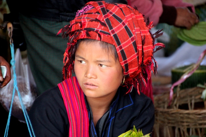 A beautiful tribal girl in the market in Inle...