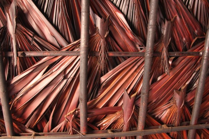The intricate craft of making a palm roof ...