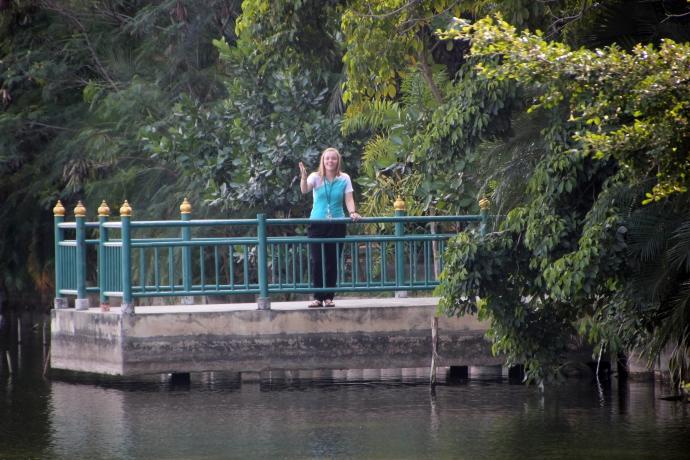 Teacher Lulu waving across the school lake...